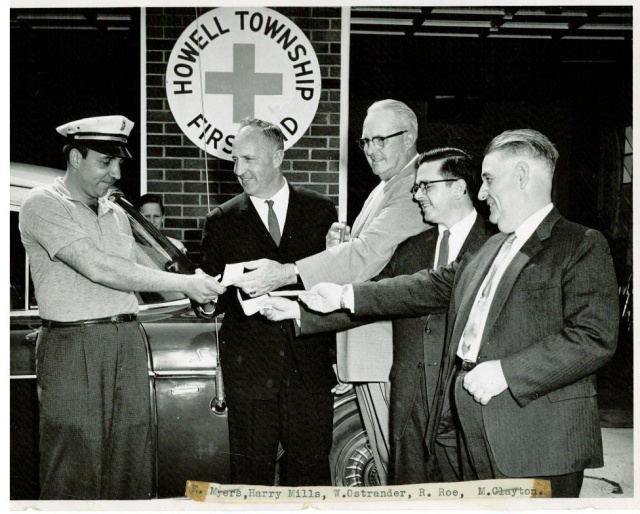 Ed Myers on left accepting keys to new ambulance
